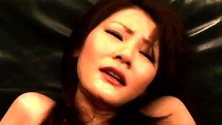 Busty Oriental slut has a gang of boys pleasing her pussy