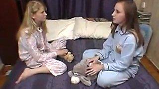 Cute lesbian girls karina and Alya on the bed