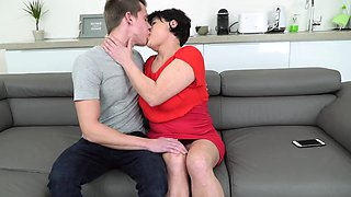 Beautiful mature is fucked on the couch by young buddy
