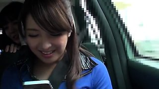 Two enticing Japanese babes pleasing a POV cock in the car