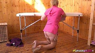 Big bottomed masseuse Rachael C shows off her cameltoe upskirt