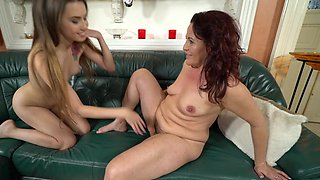 Redheaded mommy has a cute teen girl eat her pussy