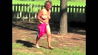 Older Female Disrobes outdoors