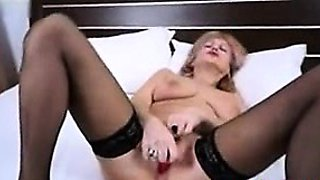 Mature Romanian Milf big tits strips and dildos pussy