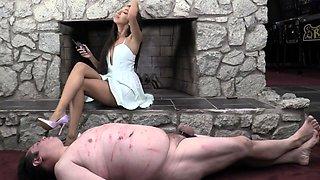 Sexy slender brunette dominatrix punishes her chubby slave