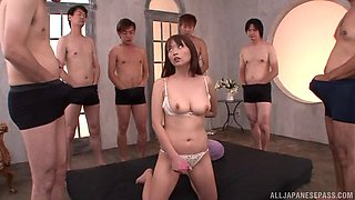 Amateur model Hana Nonoka plays with a dildo during group sex