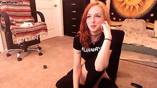 Sensuous redhead teen peels off her panties and masturbates
