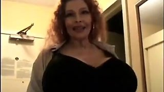 Huge tits mature tells stories and squeezes milk