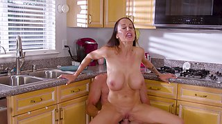 Fucking in the kitchen ends with cum in mouth for McKenzie Lee