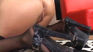Amazing lesbo in stocking riding strapon