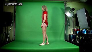 Sexy Red Dressed Gymnast Doing Spreads