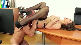 Dani is wearing black stockings, garter belt and shoes with high heels while having sex with boss