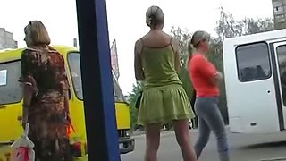 Tight shorts girl is on the bus stop