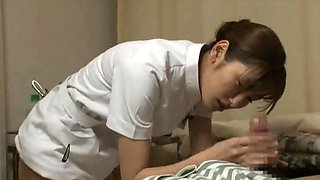 Horny Japanese nurse stuffs her hungry cunt with hard meat