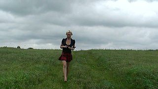 Wondrous big breasted blonde MILF flashes butt while pissing in the field