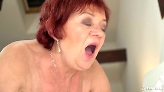 Mature redhead with saggy tits Marsha is ready for some good missionary