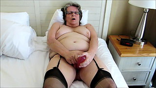 Cathy toys until she cums dressed in black nylon stockings