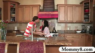 MILF catches teens fuck in her kitchen and joins them for a
