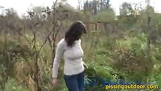Brunette autumn pissing