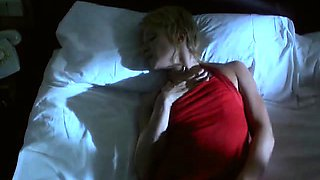 Ellen Barkin naked lying beside a stream on her back with